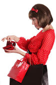 Woman with shopping bags and no money in purse — Stock Photo