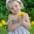 Coquettish little girl portrait with flowers — Stok fotoğraf