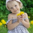 Coquettish little girl portrait with flowers — Stock Photo