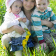 Happy mother and two children outdoor — Stock Photo