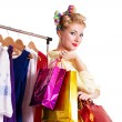 Pinup woman with shopping bags and hanger — Stockfoto