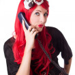 Chocked retro woman with red hair on the phone — 图库照片