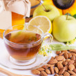 Cup of tea with linden honey, apples, almonds — Stock Photo