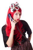 Chocked retro woman with red hair on the phone — Stock Photo