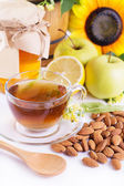 Cup of tea with linden honey, apples, almonds — Stockfoto