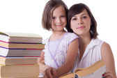 Mother and daughter reading books together — Stock Photo