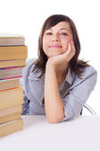 Smiling student girl with pile of books — Stock Photo