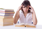 Concentrated student girl reading books — Stock Photo
