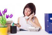 Businesswoman talking on phone at office — Stock Photo
