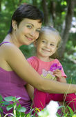 Mother and little daughter playing — Stock Photo
