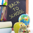 Stock Photo: Back to school supplies with clock