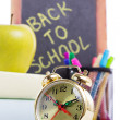 Back to school supplies with clock — Stock Photo