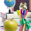 Back to school concept with stationary and apple isolated — Stock Photo