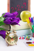 Clock, flowers and apple, back to school concept — Stock Photo