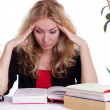 Stressed student girl with pile of books isolated — Stock Photo