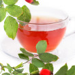Cup of rose hip tea and berries — Stock Photo