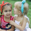 Two girls sharing secrets — Foto Stock