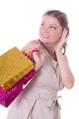 買い物袋で驚かせられる女性 — ストック写真
