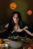 Witch practising sorcery at Halloween — Stock Photo