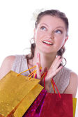 Amazed woman with shopping bags — Stock Photo