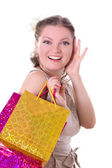 Shocked woman with shopping bags — Stockfoto