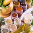 Fresh herbs, spices and oil with mortar — Stock Photo