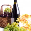 Ripe red and dark grapes and wine in basket — Stok fotoğraf