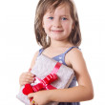 Smiling little girl holding present box — Stock Photo #30371785