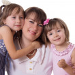 Happy mother with two little daughters — Stock Photo