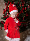 Adorable little girl putting wishes — Stock Photo