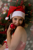 Womanwith ball next to Christmas tree — Stock Photo