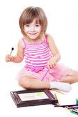 Smiling three year girl drawing — Stock Photo