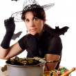 Witch making magic on Halloween — Stock Photo