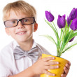 Boy in glasses and bow-tie with flowers — ストック写真