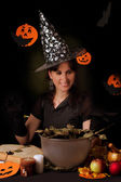 Witch practicing sorcery at Halloween night — Stock Photo