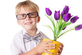 Boy in glasses and bow-tie with flowers — Stock Photo