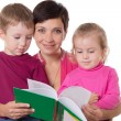 Son and daughter listening their mother reading book — Stock Photo