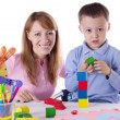 Mother and son playing with cubes — Foto Stock