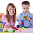 Mother and son playing with cubes — Stok fotoğraf