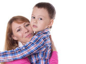 Happy mother and son hugging — Stock Photo