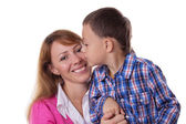 Happy mother and son kissing on cheek — Stock Photo