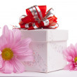 Gift-box with red bow with pink daisies — Stock Photo