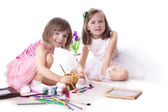 Two little girls drawing with paint — Stock Photo