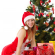 Woman under Christmas tree  — Stock Photo