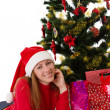 Woman under Christmas tree — Foto Stock