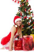 Woman under Christmas tree — Stock Photo