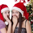 Girls sharing each other secrets on Christmas Eve — Stock Photo