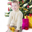 Boy with present box under Christmas tree — Stockfoto