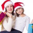 Happy mother and daughter on Christmas shopping — Stock Photo