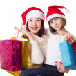 Happy mother and daughter on Christmas shopping — Zdjęcie stockowe